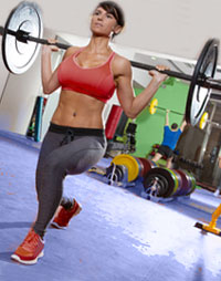 Woman performing Barbell Lunges