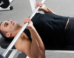 Weight Lifter demonstrating Close-Grip Bench Presses