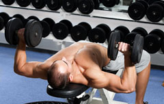 Weightlifter doing the Dumbbell Bench Press