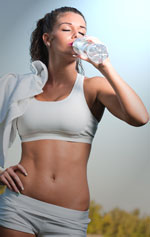 Woman Exercising and Drinking Water