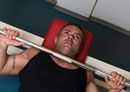 Trainer Demonstrating the Guillotine Bench Press