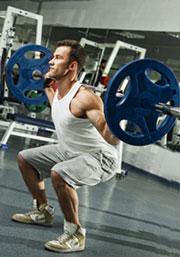 Lifter doing heavy squats