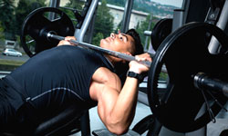 Trainer doing Incline Bench Presses