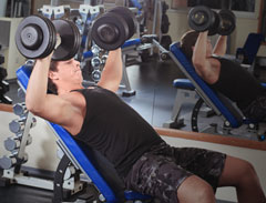 Trainer doing Incline Dumbbell Bench Presses