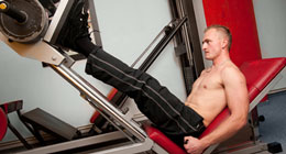 Trainer doing the leg press