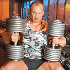 Man Lifting Large Dumbbells