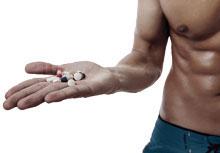 Bodybuilder taking Multi-Vitamins