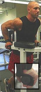 Trainer doing dips using Newgrips