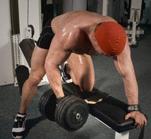 Trainer doing One-Arm Dumbbell Rows