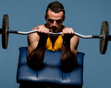 Front view of man doing Preacher Curls