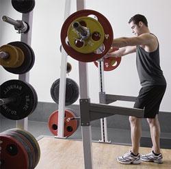 Bodybuilder at Squat Rack