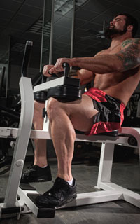 Trainer Demonstrating Seated Calf Raises