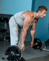 Trainer demonstrating Stiff-Leg Deadlifts