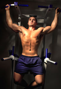 Bodybuilder Demonstrating Wide-Grip Pull-Ups